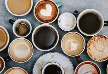 top view photo of ceramic mugs filled with coffees