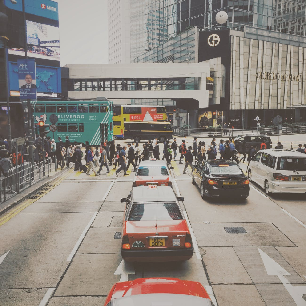people crossing in pedestrian lane in city during daytime