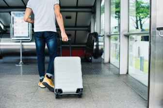 person pulling travel luggage