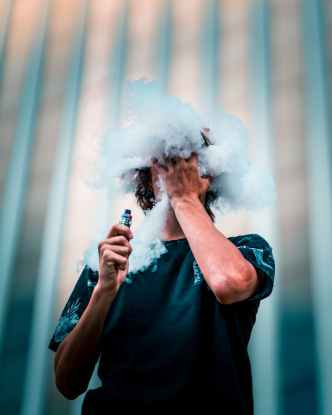 selective focus photography of man doing vape trick