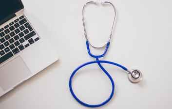 computer desk laptop stethoscope