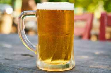 beer filled mug on table