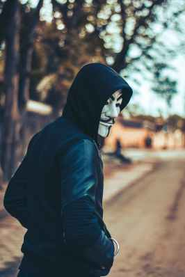 man wearing hoodie and mask