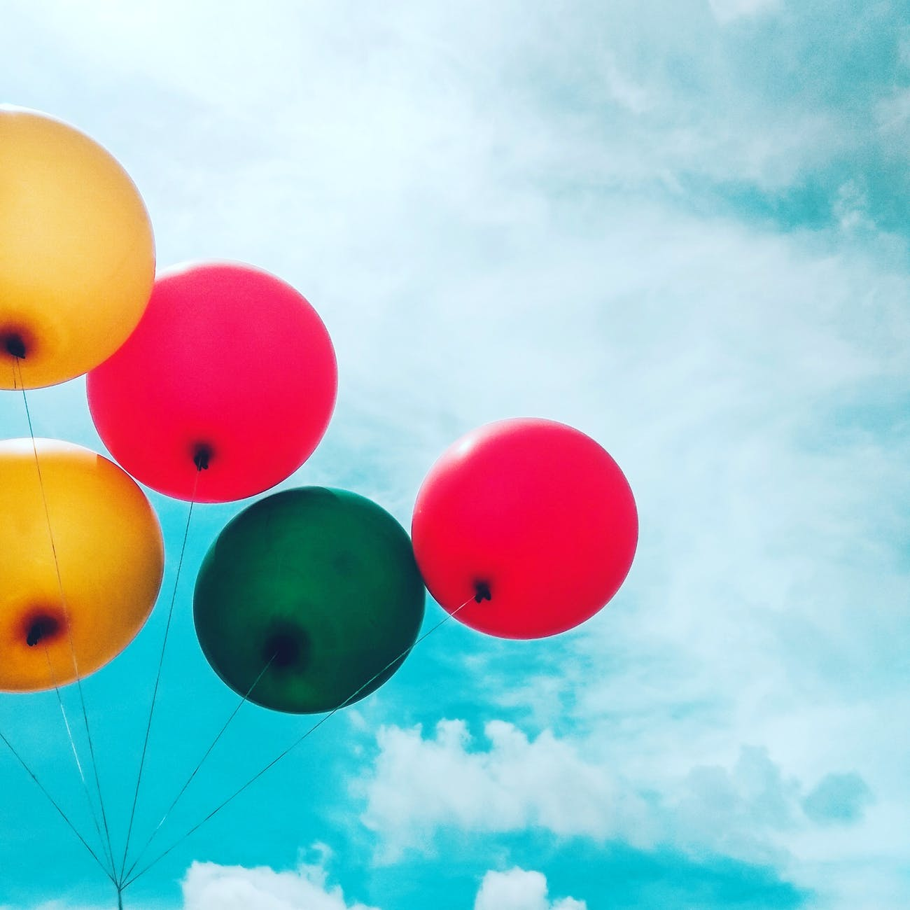 five assorted balloons